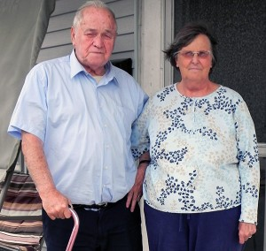 Linda Metzger with husband Bill outside their house