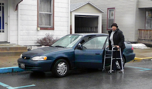 Regina Russell needs to use a Walker to get to and from her vehicle.