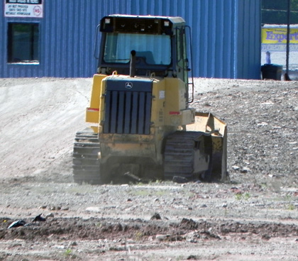 Bulldozer parked on site at Celotex, Sunbury