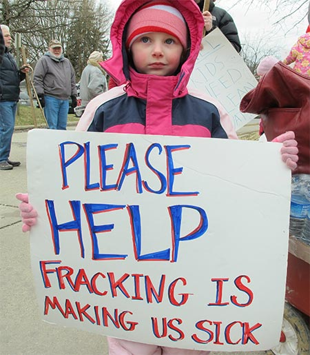 Child demonstrates at anti-fracking rally.